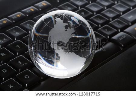 Globe and keyboard. - stock photo