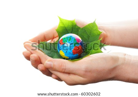 globe and leaf in hands for environmental conservation
