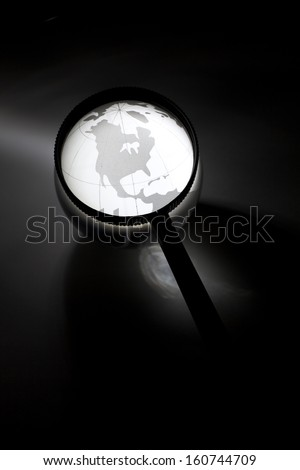 Globe and Magnifying Glass for background
