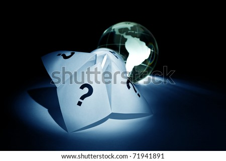 Globe and Paper Fortune Teller for background - stock photo