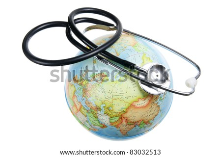 Globe and Stethoscope on White Pages - stock photo