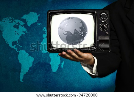 globe and tv in hand of business man (media intervention)