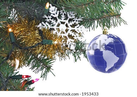 globe as ornament on christmas tree - stock photo