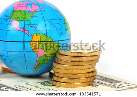 Globe, coins and dollars on a white background - stock photo