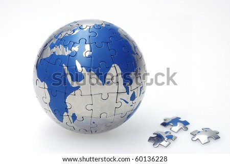 Globe collected from puzzle parts isolated on white - stock photo