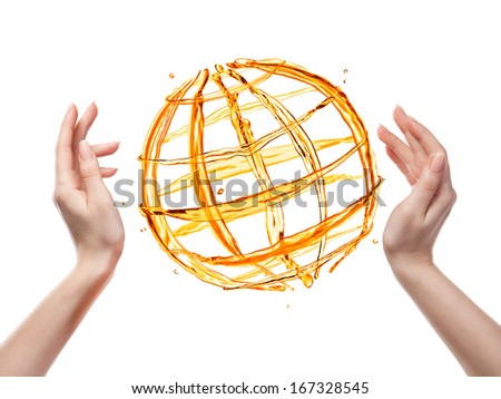 Globe from orange water with human hand isolated on white - stock photo