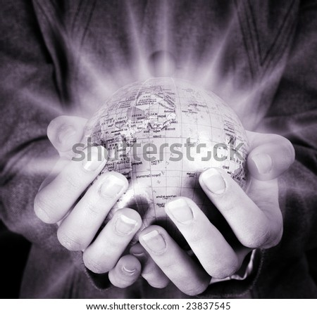 Globe in a girl's hands. Macro image