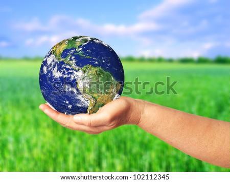 Globe in arm - stock photo