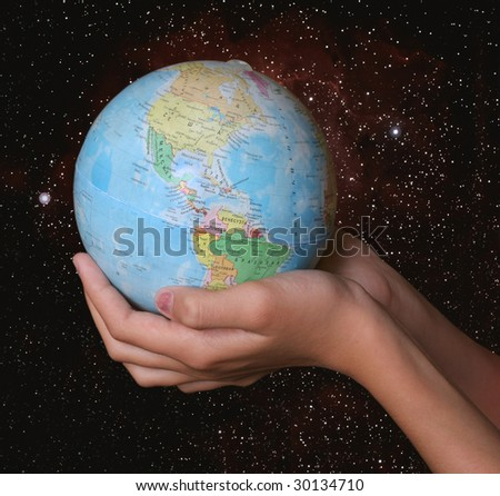 globe in hands on space background - stock photo