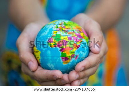 Globe in hands. The whole world in your hands. Protect the world from war and disaster. - stock photo