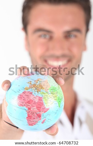 Globe in the hand of a man - stock photo