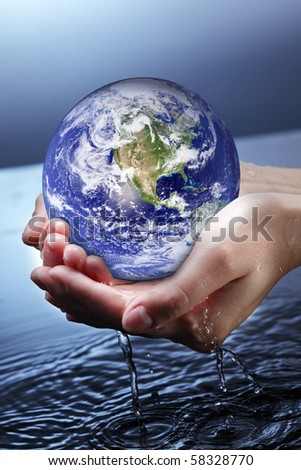 globe in woman hand - stock photo