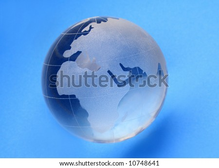 globe isolated on blue background with reflection - stock photo