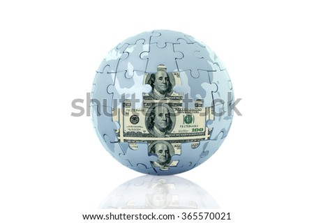 Globe jigsaw puzzle while some parts dropped and we see a hundred US dollars inside. Isolated on white background with drop shadow.