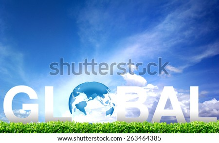 Globe lies on green grass. Concept - stock photo