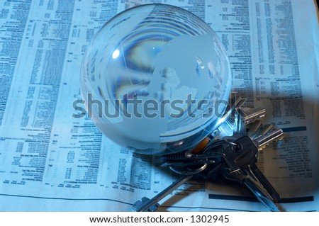 globe made of glass on newspapers - stock photo