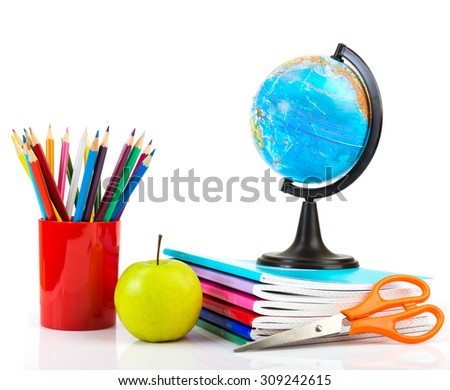 Globe, notebook stack and pencils. Schoolchild and student studies accessories. - stock photo