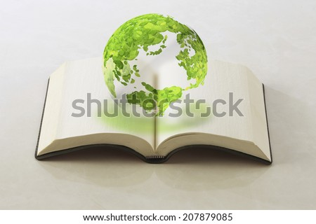 Globe Of Leaf And Book - stock photo