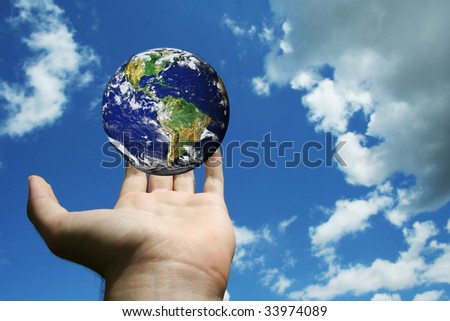 globe of planet earth in man hand