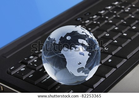 globe on a laptop keyboard