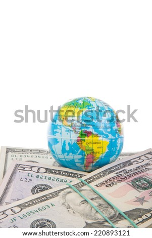 globe on american dollars (isolated) - stock photo