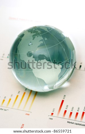 Globe on business documents - stock photo