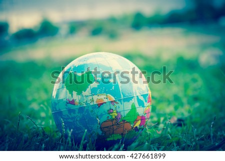 globe on green  Grass vintage tone - stock photo