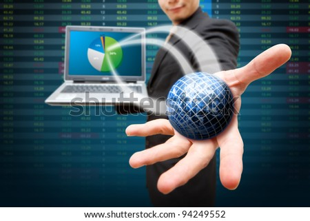 Globe on notebook computer and present the pie chart - stock photo