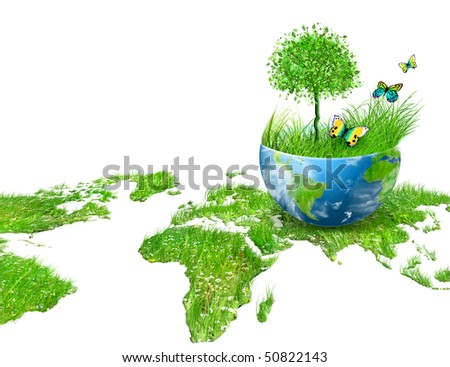 Globe on the green grass - stock photo