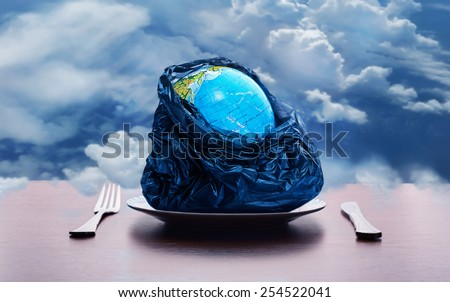 Globe on the plate - stock photo