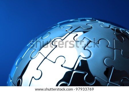 Globe puzzle concept for business solutions and strategy on blue background - stock photo