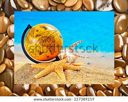 Globe, shells, starfish in the beach near the ocean. Frame with stones. Collage - stock photo