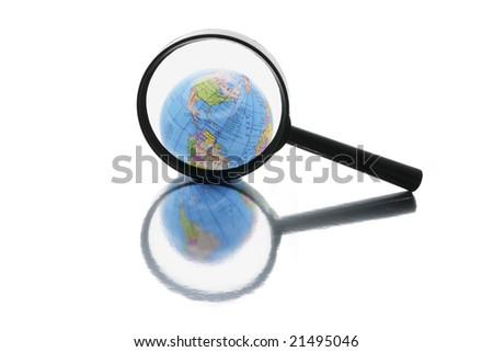 Globe under Magnifying Glass on Isolated White Background - stock photo