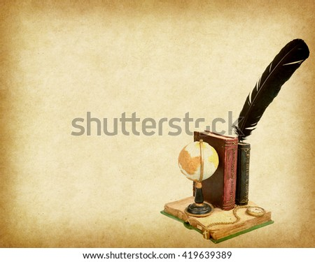 globe with book,pen on Old antique vintage paper background - stock photo