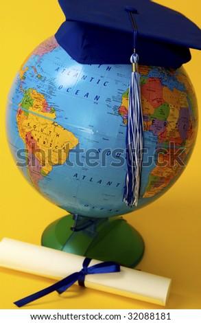 Globe with diploma - stock photo