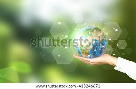 Globe with networking system in businessman's palm on abstract blue background. Elements of this image furnished by NASA - stock photo