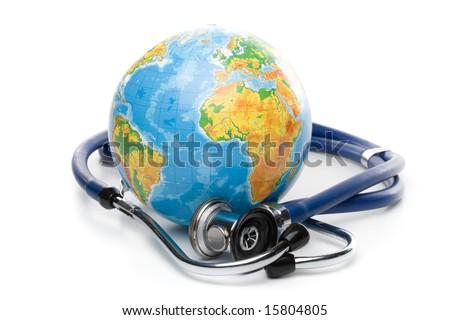 Globe with stethoscope on a white background - stock photo