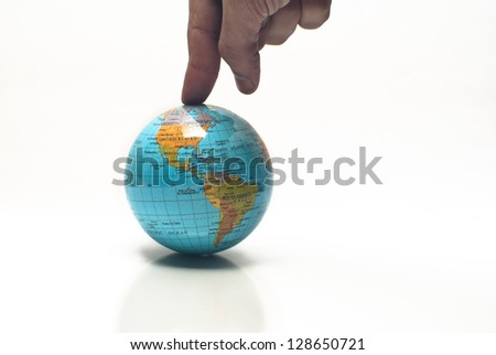 Globe ,world in a finger, isolated on white - stock photo