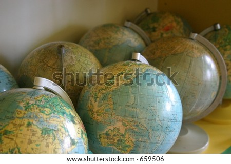 Globes in classrom - stock photo