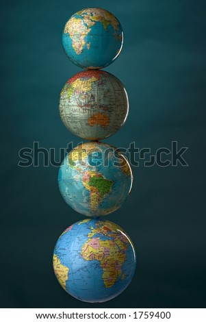 globes stuck upon each other - stock photo