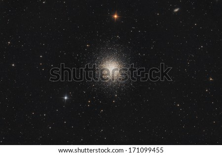 Globular star cluster in mysterious universe. - stock photo