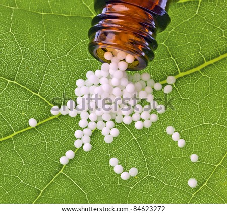 globules in the treatment of diseases in the gentle, alternative medicine. tablets and medicines. - stock photo