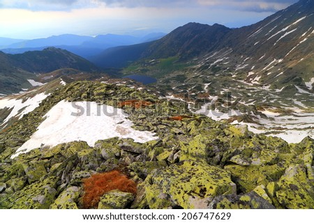 Gloomy atmosphere on the mountains at evening - stock photo