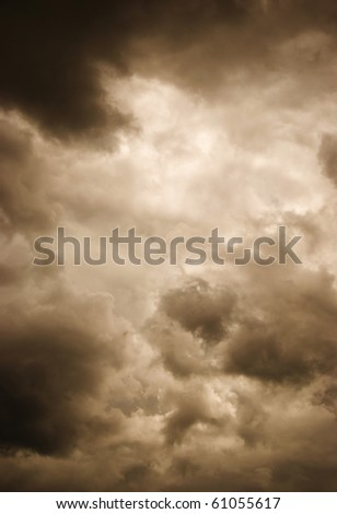 Gloomy clouds have shrouded the sky before a thunder-storm. Stylized photo - stock photo