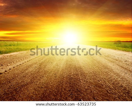 Gloomy dawn on rural road. - stock photo
