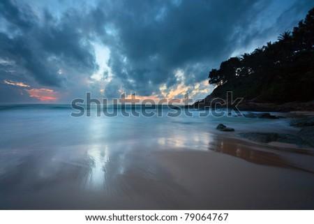 Gloomy tropical sunset at the beach. Thailand - stock photo