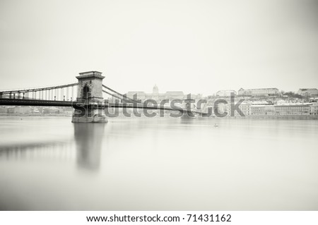 Gloomy winter  image of  Hungarian landmarks, Chain Bridge, Royal Palace and Danube river in Budapest. - stock photo