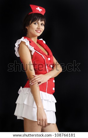 Glorious girl dressed as a nurse on a white background