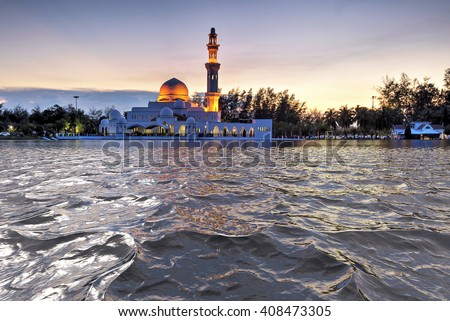 Glorious sunset at mosque.  - stock photo