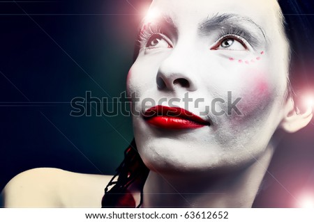 glory portrait of a strange woman mime or a clown and bodypainting - stock photo